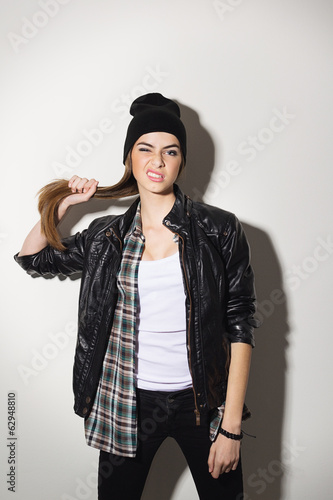 Cute teenage hipster girl posing