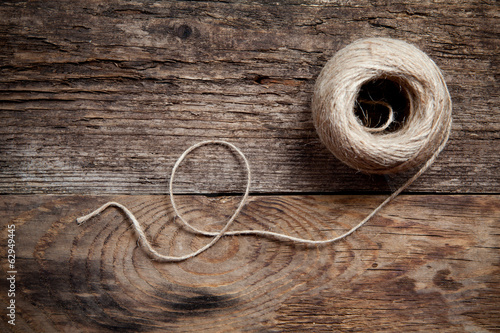 Rope coil on old wooden background