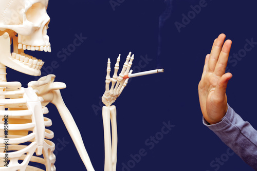 man gesturing disclaims proposed cigarette