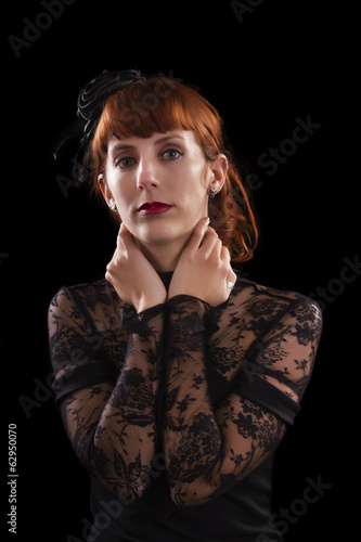 girl on a black gothic dress with red hair