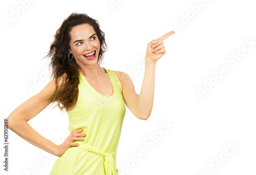 Happy positive woman pointing