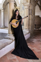 beautiful girl dressed as a fado performer