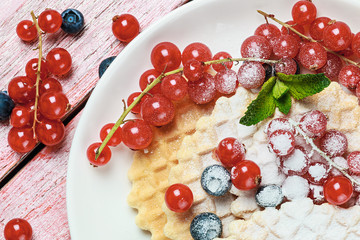 Dessert with Belgian waffles and berries