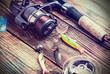 fishing tackle on a wooden table - 62950615