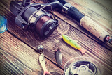 Fototapety fishing tackle on a wooden table