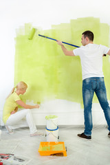 Couple together painting wall