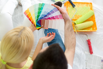 couple choosing colors to paint new house