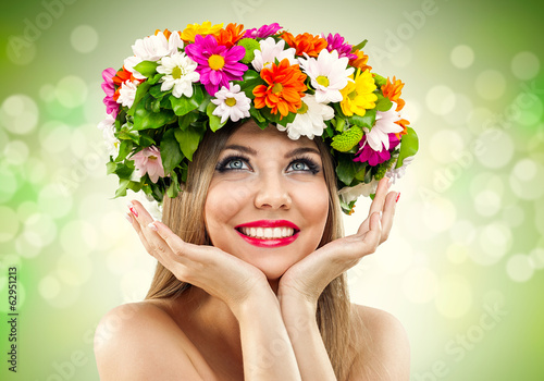 beauty woman with wild of fresh flowers
