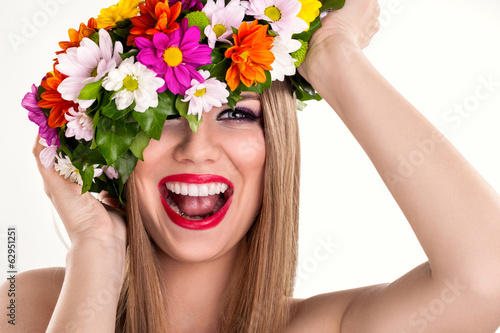 Laughing woman with flower wreath