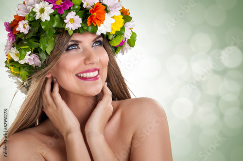 Dreamy woman with flower on head