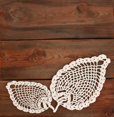 vintage doily on a wooden background
