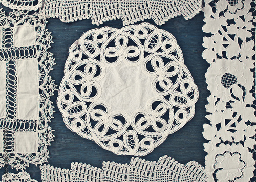 Lace doily on the painted wooden background