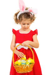 Lovely girl checking Easter eggs