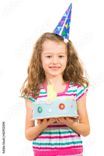 Smiling girl with birthday cake