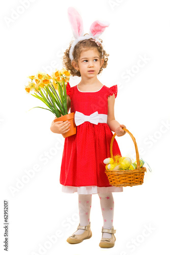 Girl with Easter basket looking away