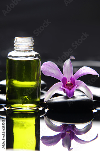 Poster Spa Still life with pink orchid ,massage oil and zen stones