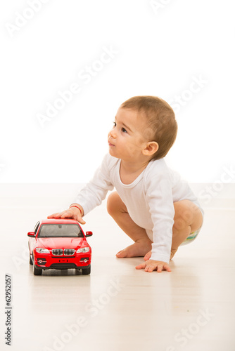 Boy with toy car looking away