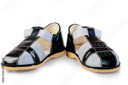 pair of leather sandals for children isolated on white backgroun