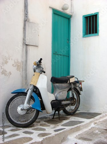 Old Italian Motorbike and Green Wooden Door