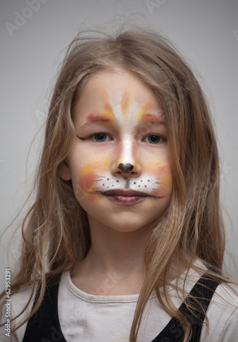 little girl with cat painting makeup portrait