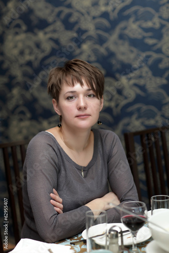Serious woman in restaurant