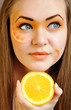 Young beautiful woman with creative orange makeup with orange