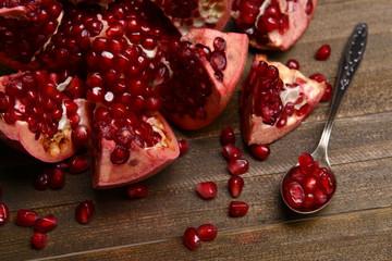 Ripe pomegranate on table close-up