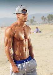 Bodybuilder on beach