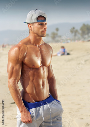 canvas print picture Bodybuilder on beach
