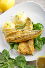 Fillet of sea bream with mashed potatoes, spinach and lemon