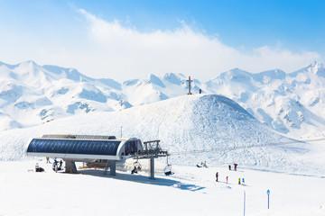 Skiers on ski lift on Vogel, Slovenia.
