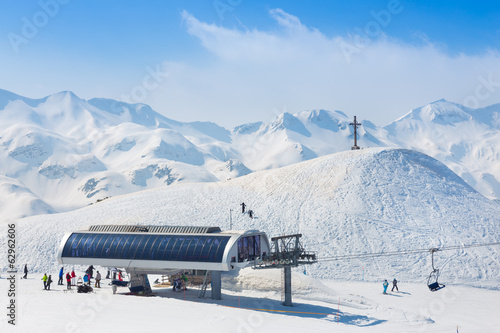 canvas print picture Skiers on ski lift on Vogel, Slovenia.