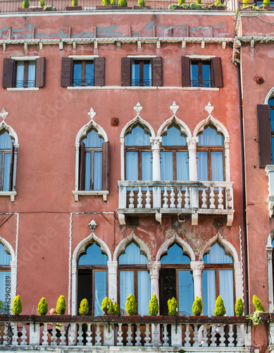 Ornate Windows on Red Plaster Venice Hotel