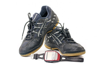 Grey sport shoes with stopwatch