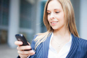 Business woman using her smartphone