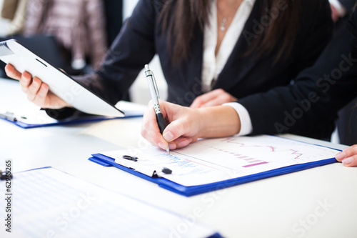 Business people taking notes