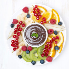 assorted fruit with chocolate sauce, top view © cook_inspire
