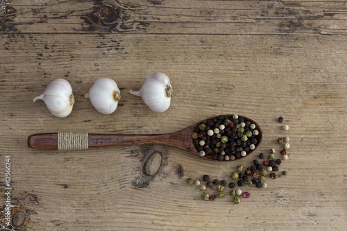 Garlic and peppercorn on wooden background