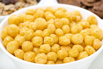 corn balls and breakfast cereals, close-up, selective focus