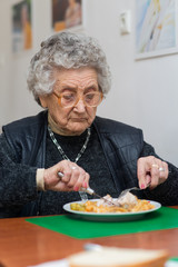 senior woman eating her lunch