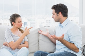 Couple having a serious argument on the couch