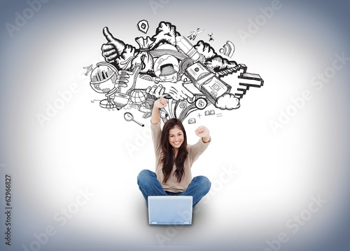 Cheering girl using laptop with doodles