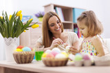 Fototapety Loving family in easter holiday painting eggs