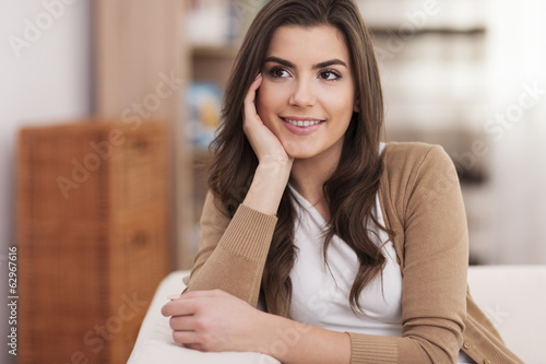 Portrait of smiling and beautiful woman at home
