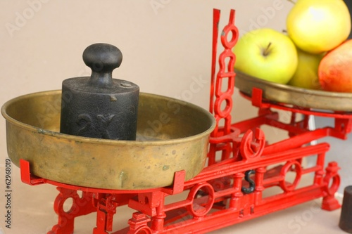 Old vintage kitchen balance scale with apples and weights