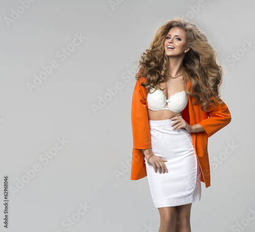 Fashion shot of a woman in orange coat
