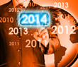 Businessman touching new year 2014