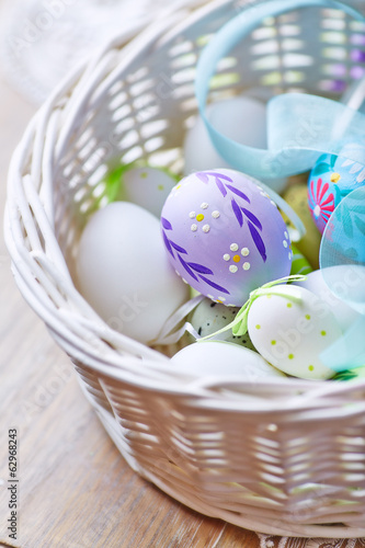Close up of Easter Eggs in a White Basket