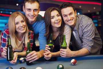 Party with friends in nightclub with billiards