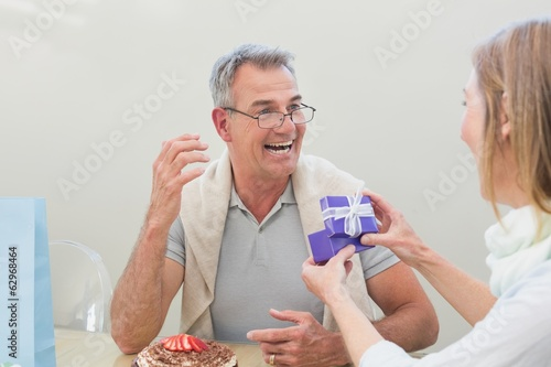 Cheerful man receiving a gift